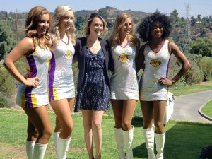 Cancer Survivor Nicole, and the Laker Girls, standing on the greens of San Dimas Canyon Golf Course at ServiceMaster By T.A. Russell's golf outing fundraiser