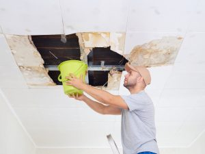 Man-Catching-Water-from-Ceiling-Leak