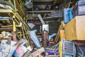 Hoarding Cleaning services are needed in this Cambridge, MA garage: Big mess in an over stuffed suburban garage.