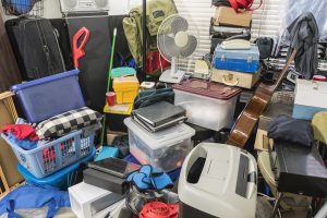 Hoarding cleaning services in Cambridge, MA are needed here: home packed with stored boxes, vintage electronics, files, business equipment and household items.