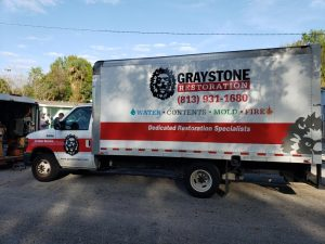 Graystone Restoration truck on the road
