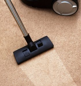 residential carpet cleaning with a vacuum in Dover, NH