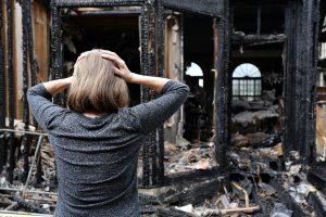 Fire-Damage-Woman-Stressed