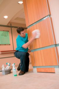 Technician Cleaning Wall Providence RI