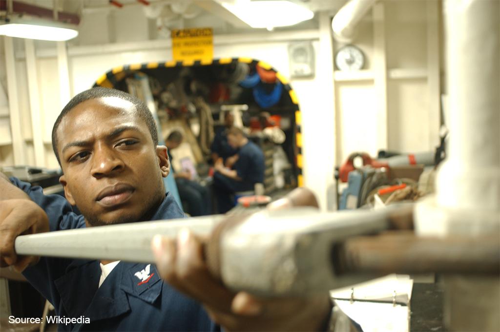 A technician performs maintenance
