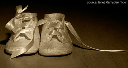 Infant shoes associated with memories.