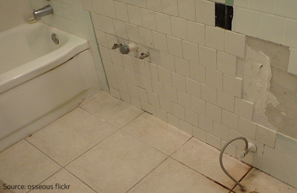 Inspect the floor and the walls for cracks and softer spots.