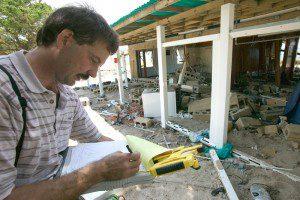 Insurance agent assessing damage 2