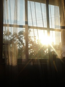 The heat from the sunlight is more intense when passing through glass.