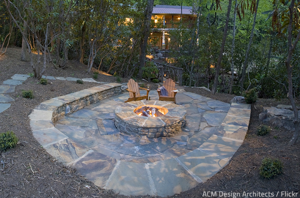 Stone patio designs with fire pit provide a way to enjoy nature within the comfort of your home.
