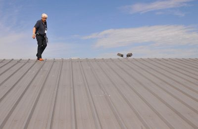 How Quarterly Commercial Roof Checks and Maintenance Save Time and Money