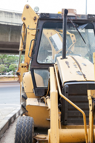 Backhoes are often used in commercial and residential reconstruction.