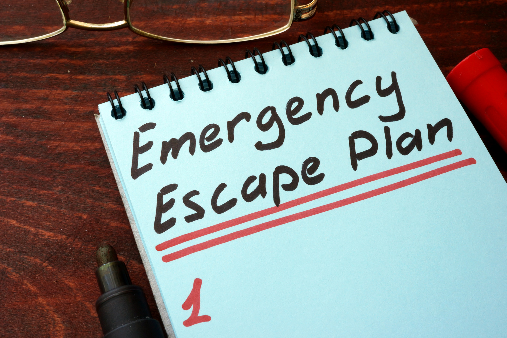 Emergency Escape Plan written on a notepad with marker.