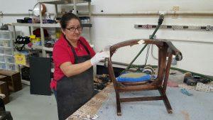 Furniture Medic Team restoring wooden chair in West Chicago IL