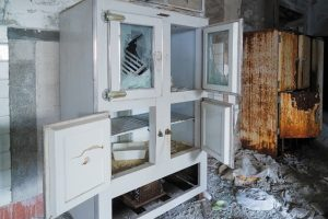 fire and smoke damage done to a kitchen cabinet