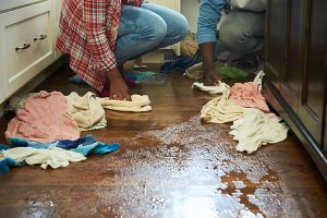 Water damage cleanup and water damage restoration services from ServiceMaster are needed for this wooden floor - rags alone won't cut it.